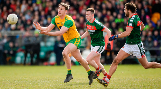 Donegal's Hugh McFadden attempts to get away from Tom Parsons during last weekend's drawn game in Ballybofey Photo: Sportsfile