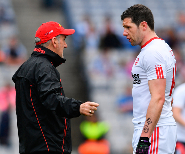 Mickey Harte chats to Seán Cavanagh in Croke Park last August – the Tyrone manager has been the subject of criticism from his former player this year. Photo: Sportsfile