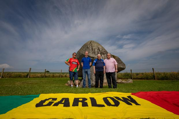 Getting behind the Carlow flag (l to r) are Keith Gavin, Mark Carpenter, Brendan Hayden and John Brophy. Photo: Dylan Vaughan