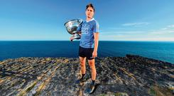 Dublin's Mick Fitzsimons with the Sam Maguire Cup at Dún Aengus on the Aran Islands, where the launch of the All-Ireland SFC series took place yesterday. Photo: Sportsfile