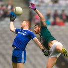 Kieran Hughes of Monaghan and Kildare defender Johnny Byrne in an aerial duel for possession during yesterday's clash Photo: Sportsfile
