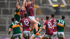 Thomas Flynn and Seán Andy Ó Ceallaigh of Galway compete for a high ball against Kerry's Seán O'Shea and six other players in Croke Park yesterday Photo: Sportsfile