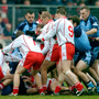 Tyrone and Dublin players scuffle on the pitch during the infamous 'Battle of Omagh' that saw four players sent off in 2006. Photo: Sportsfile