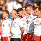 Mickey Harte, standing with his players. Photo: Sportsfile