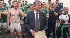 JP McManus celebrates with the Liam MacCarthy Cup in the Limerick dressing room after the county ended their 45-year famine