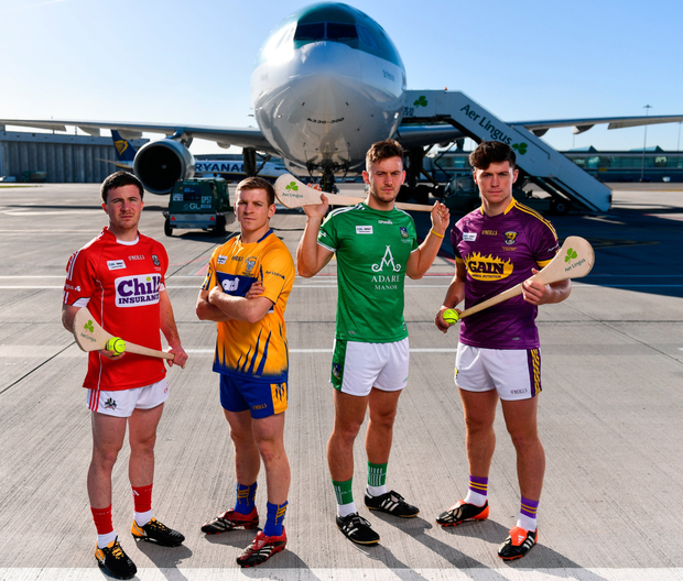 Daniel Kearney (Cork), Podge Collins (Clare), Tom Morrissey (Limerick) and Conor McDonald (Wexford) at Dublin Airport yesterday for the Aer Lingus jersey launch of the 2018 Fenway Hurling Classic. Photo: Sportsfile