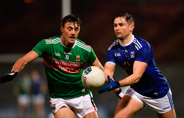 Cavan's Stephen Murray in action against Mayo's Diarmuid O'Connor during last night's Allianz League match in Castlebar. Photo: Seb Daly