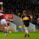 Johnny Buckley of Dr Crokes and Mullinalaghta's John Keegan battle for possession during yesterday's AIB All-Ireland Club Championship semi-final in Semple Stadium yesterday. Photo: Sportsfile