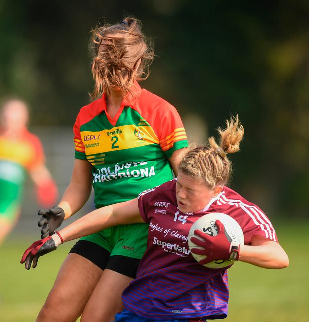 Hannah Walsh of Coláiste Bhaile Chláir, Claregalway is challenged by Aoife Mallon of St Catherine's, Armagh during the Lidl All-Ireland P-P Schools at Mohill on Saturday – St Catherine's won by 3-4 to 2-3. Photo: Stephen McCarthy/ Sportsfile