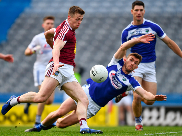 John O'Loughlin of Laois tries to get back and block Ger Egan's effort on goal but the Westmeath man neatly slots home for the game's only goal. Photo: Ray McManus/Sportsfile