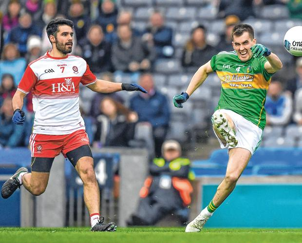 Derry's Niall Keenan (left) in action against Paddy Maguire of Leitrim during the Allianz Football League Division 4 Final in March. Photo: Sportsfile