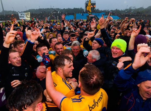 Roscommon players and supporters celebrate in MacHale Park last night. Photo: Stephen McCarthy/Sportsfile