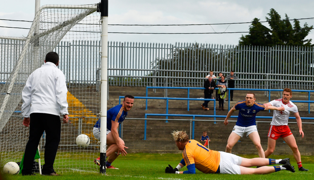 Tyrone's Cathal McShane puts the ball in the net past Longford goalkeeper Paddy Collum. Photo: Sportsfile