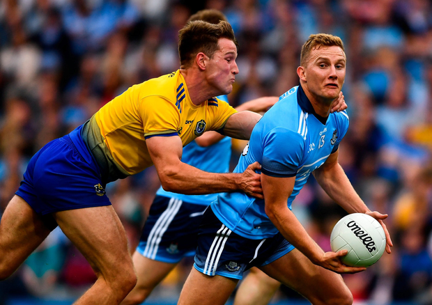 Hands on: Dublin's Ciaran Kilkenny does his best to escape the clutches of Roscommon's Sean Mullooly. Photo: Ray McManus/Sportsfile
