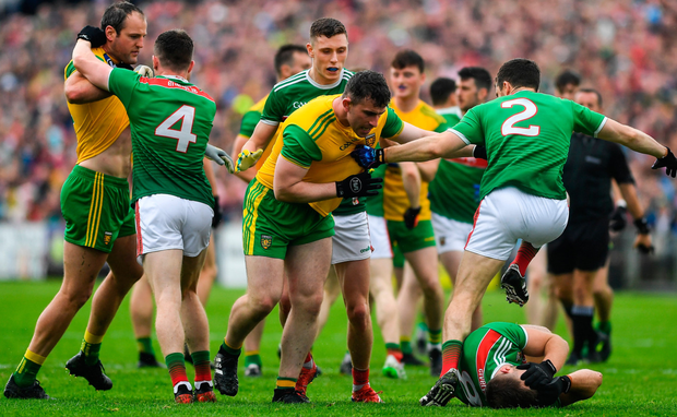Michael Murphy and Paddy McBrearty of Donegal clash with Eoin O'Donoghue and Chris Barrett as Aidan O'Shea lies injured. Photo: Brendan Moran. Photo: Sportsfile