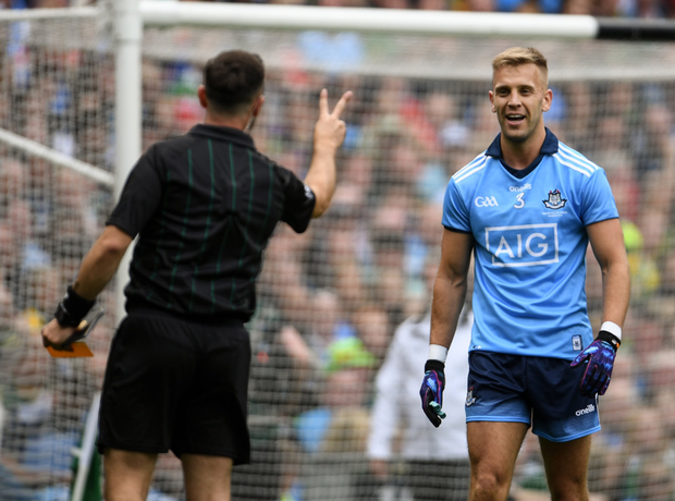 David Gough signals for two fouls to Jonny Cooper after showing him his first yellow card last Sunday. Photo: Sportsfile