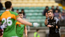 Referee Anthony Nolan awards a free for four consecutive handpasses during the O'Byrne Cup Round 1 match between Carlow and Westmeath at Netwatch Cullen Park in Carlow Photo: Stephen McCarthy/Sportsfile