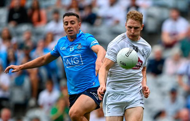 Daniel Flynn of Kildare is tackled by Dublin's Cormac Costello at Croke Park on Sunday. Photo: Sportsfile