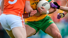 Donegal captain Michael Murphy holds off the Armagh tackles