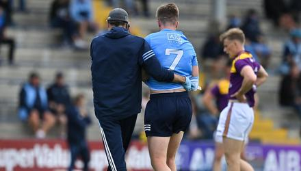 An injured Robbie McDaid leaves the field during the Leinster SFC quarter-final between Wexford and Dublin. Photo: Brendan Moran/Sportsfile