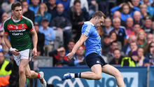 Lee Keegan tries to distract Dean Rock by throwing a GPS unit into his path at the climax of the 2017 All-Ireland final. Photo: Sportsfile