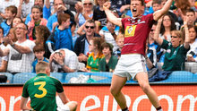 John Heslin celebrates after scoring Westmeath's late goal in front of Meath full-back Cormac McGill RAMSEY CARDY / SPORTSFILE