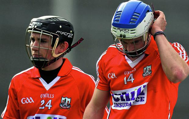Cork's Luke O'Farrell and Brian Hartnett after defeat to Clare saw the Rebels relegated from Division 1A