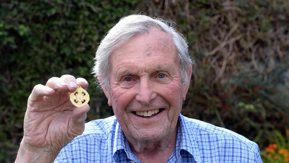 Paddy Prendergast, fullback on the last Mayo senior football team to win an All-Ireland in 1951 proudly holding his All-Ireland medal at home in Ballinorig, Tralee