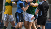 Dublin's Bernard Brogan and Emmet O Conghaile tussle off the ball with Kerry's Peter Crowley and Brendan Kealy, in front of referee Eddie Kinsella, during this year's league match
