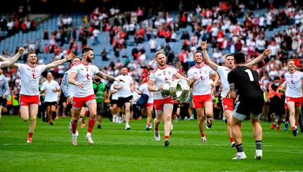 Tyrone players celebrate with the Sam Maguire led after their victory over Mayo in Croke Park. Photo: Seb Daly