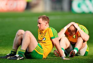 Donegal's Anthony Thompson, left, and Dermot Molloy dejected at the final whistle