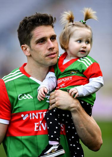 Lee Keegan of Mayo with his one-year-old daughter Líle after the loss to Tyrone
