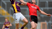 Wexford's Syl Byrne in action against Down's Peter Fitzpatrick during their Qualifier clash in Wexford Park