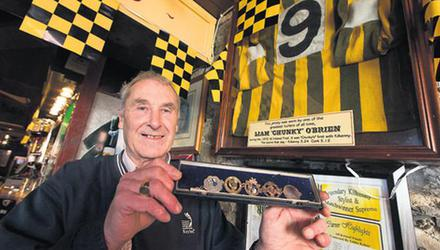 Liam 'Chunky' O'Brien with his medals in Breathnach's pub in John Street, Kilkenny back in 2012