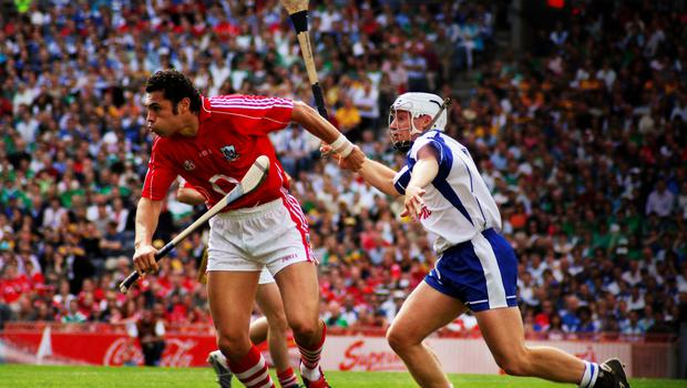 Sean Og O hAilpin tries to get away from Stephen Molumphy during Cork's battle with Waterford in 2007