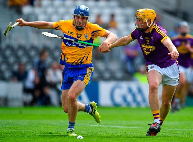 Clare's Shane O'Donnell in a race for the ball against Damien Reck of Wexford. Photo: Brendan Moran/Sportsfile
