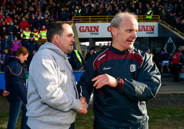 Davy Fitzgerald (left) is a contender for the Galway senior hurling job after Mícheál Donoghue (right) pulled out of the race, according to local media