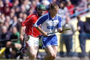 Eoin McGrath, Waterford, in action against Declan Prendergast, Cork during the 2004 Munster Hurling Championship final