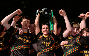 John The Baptist CS captain Paudie Maher lifts the Paddy Buggy Cup. Photo: Sportsfile