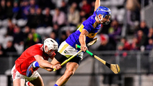 Tipperary's John McGrath is tackled by Cork's Tim O'Mahony during last night's match in Páirc Uí Chaoimh. Photo: Eóin Noonan/Sportsfile