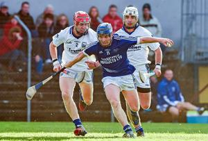 Padraic Collins, Cratloe, in action against Stephen Maher, left, and David Maher, Thurles Sarsfields