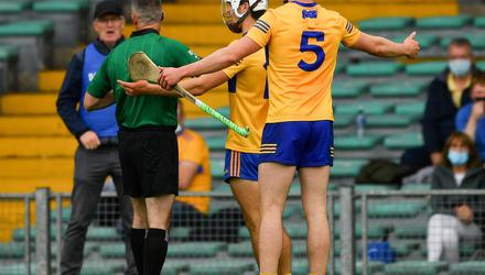 Diarmuid Ryan of Clare appeals to referee James Owens after he had issued a controversial yellow card to his team-mate Aidan McCarthy, 12, during the Munster hurling semi-final against Tipperary. Photo: Ray McManus/Sportsfile