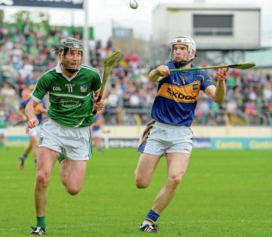 There was nothing but 100 per cent effort went into Tipperary's clash with Limerick as Donal O'Grady and Brendan Maher battle for possession