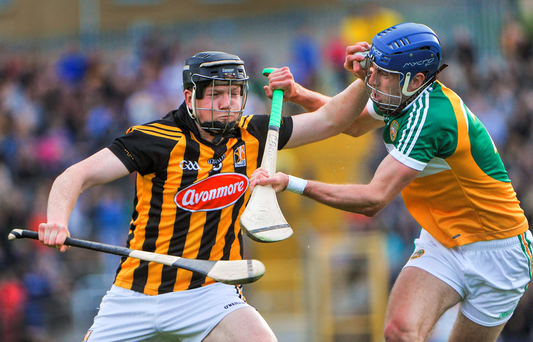 Kilkenny's Walter Walsh holds off the challenge of Cathal Parlon, Offaly