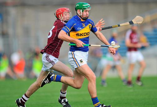 Noel McGrath, Tipperary, in action against Cathal Mannion, Galway