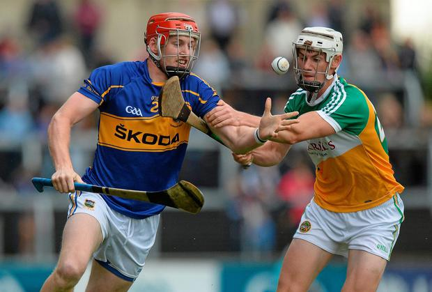 Denis Maher, Tipperary, in action against Emmett Nolan, Offaly