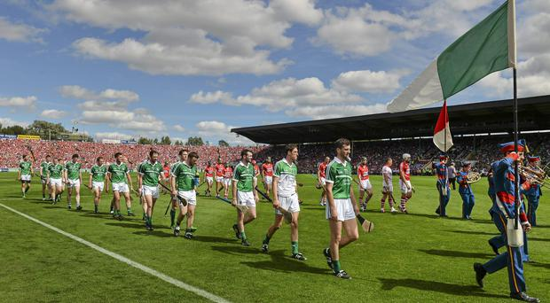 Limerick march before the 2014 Munster SHC final