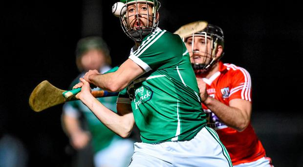 Cathal King, Limerick, in action against Glen O'Connor, Cork