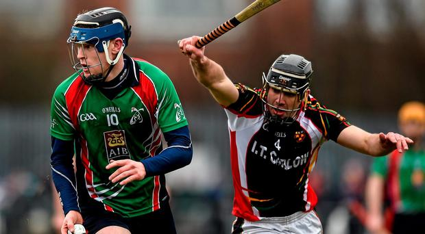 Paul Flaherty, Limerick IT, without his hurley, in action against James Gannon, IT Carlow