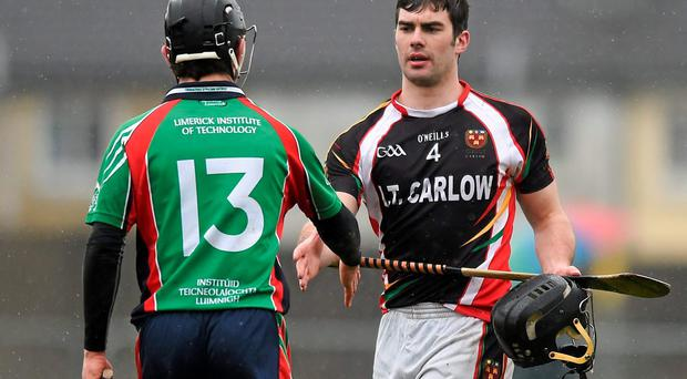 James Gannon, IT Carlow, and David Reidy, Limerick IT, exchange a handshake after the game
